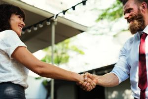 Man and woman shaking hands